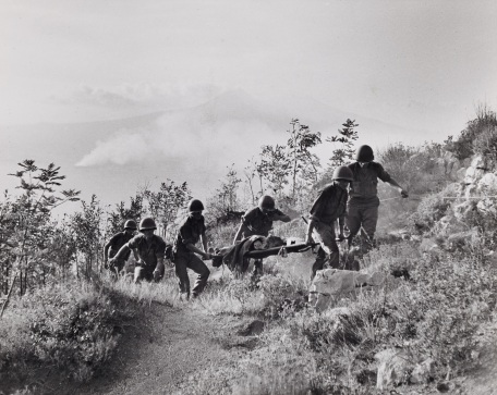 "S-1882, ""Along the road to Naples, American troops carrying a wounded near Chiunzi Pass"""
